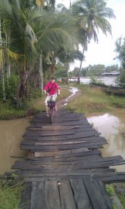 Islands-Roo-biking-on-bridge